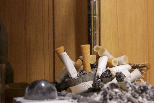 喫煙マンションを売る